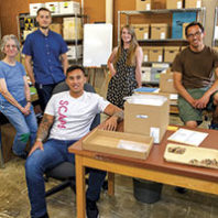 WSU veterans and staff in anthropology archives room