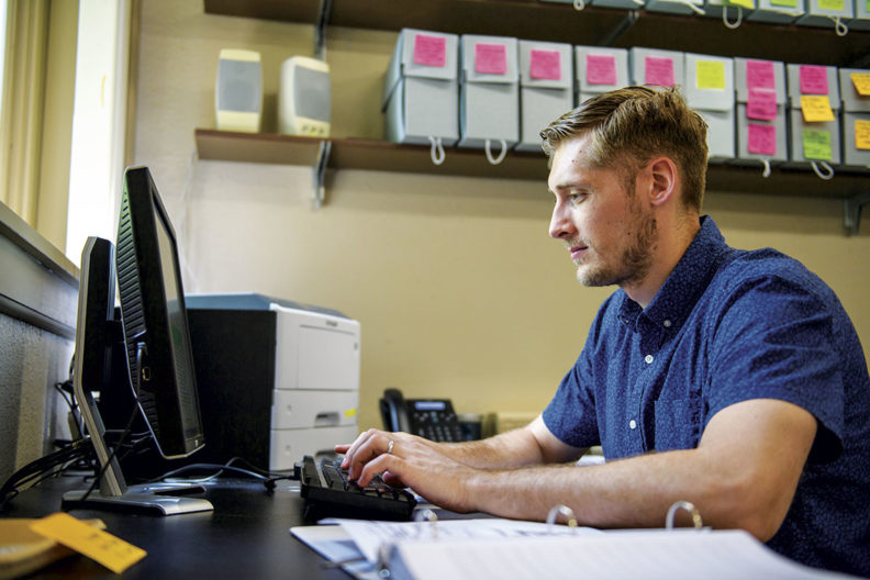 WSU student and veteran Stephen Bergquist works on a computer cataloging ancient artifacts