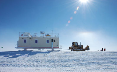 Walden's mobile research facility in Greenland being pulled by a tractor