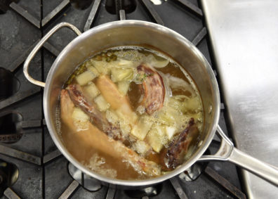 Simmering roast neck and wingtips with stock. Photo Shelly Hanks