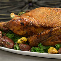 Roast goose with brussels sprouts and potatoes