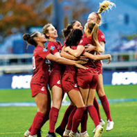 WSU team celebrates a goal at Women's Soccer College Cup 2019