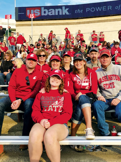 The Rightmire extended family of Cougs at a game in Martin Stadium