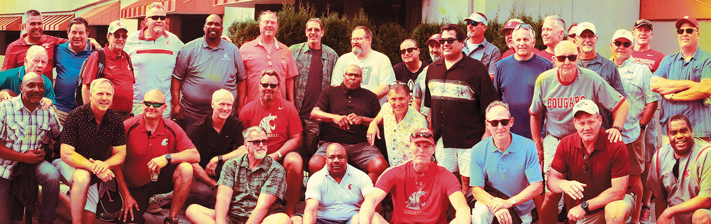 WSU Holiday Bowl team of 1981, including 32 players, four coaches, and the head trainer at a reunion in 2019