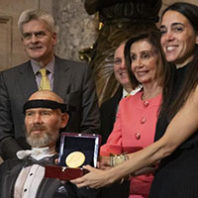 Steve Gleason receives the Congressional Gold Medal surround by his family, House Speaker Nancy Pelosi, and other members of Congress