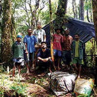 Research group gathered in forest in Papua Guinea