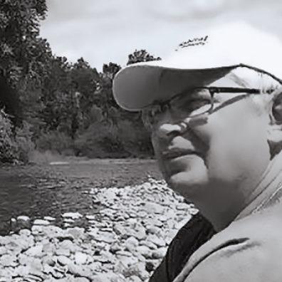 Marty Kooistra next to river