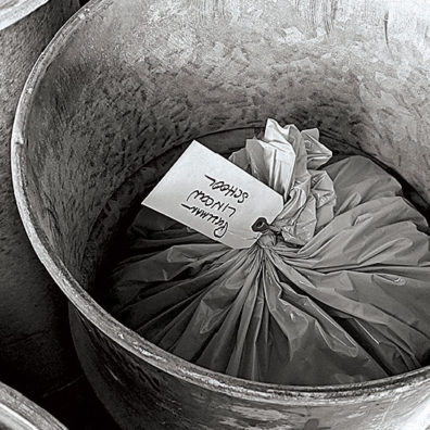 Plastic bag of ash from Mount St. Helens in a barrel stored near Pullman