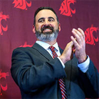 Nick Rolovich claps at his introduction as the new football coach at WSU