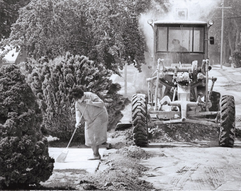 Woman sweeps ash in Ritzville after the eruption of Mount St. Helens