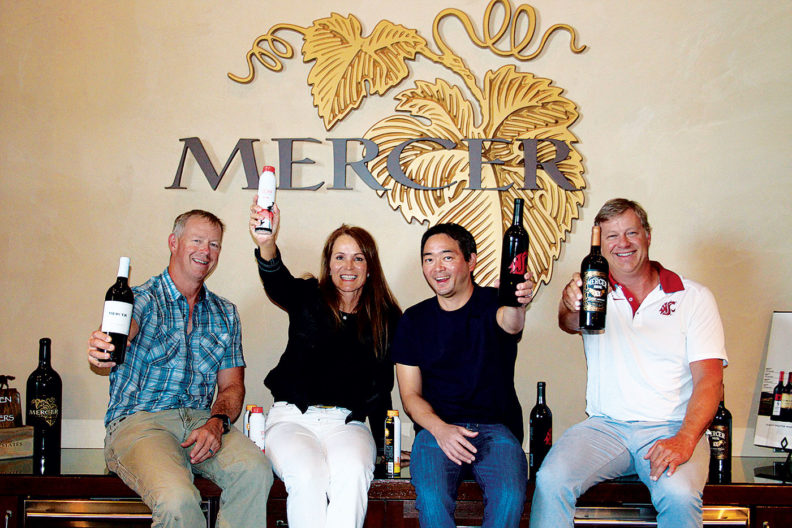 Mercer Estates staff raising bottles of their wine