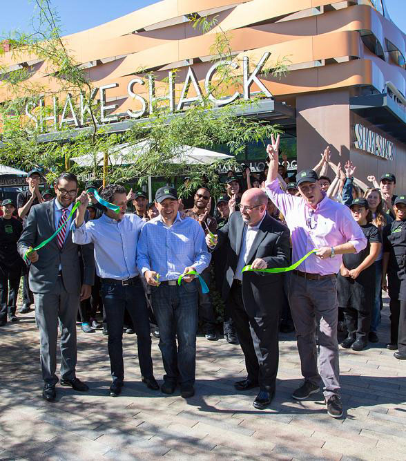 Shake Shack leaders in front of a store