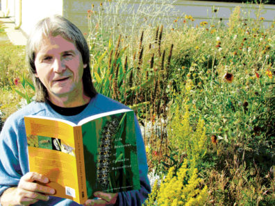 David James with his book Life Histories of Cascadia Butterflies