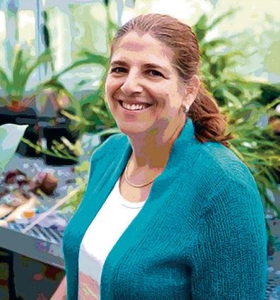 Cheryl Schultz in a greenhouse