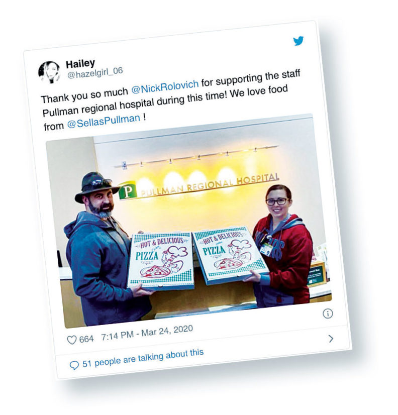Instagram of Nick Rolovich giving pizza