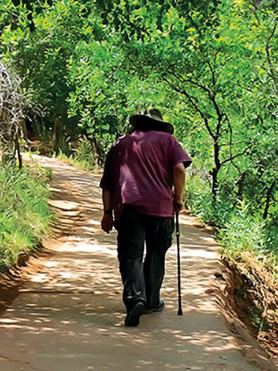John Streamas walking along a path