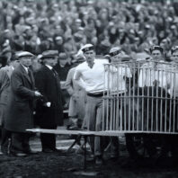Washington State College Cougar Guard in 1927 with live Butch cougar in a cage