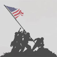 silhouette of soldiers raising flag on Iwo Jima