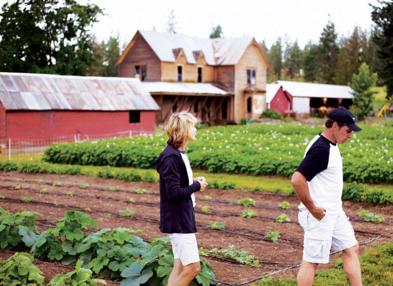 Jim and Connie Long walk in a field at Fresh Cut Farms