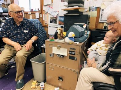 Duane and Arleen and great-grandson Archer at store office, 2020