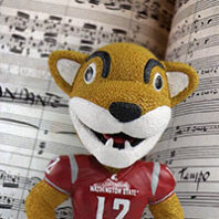 Butch Cougar in front of music sheet