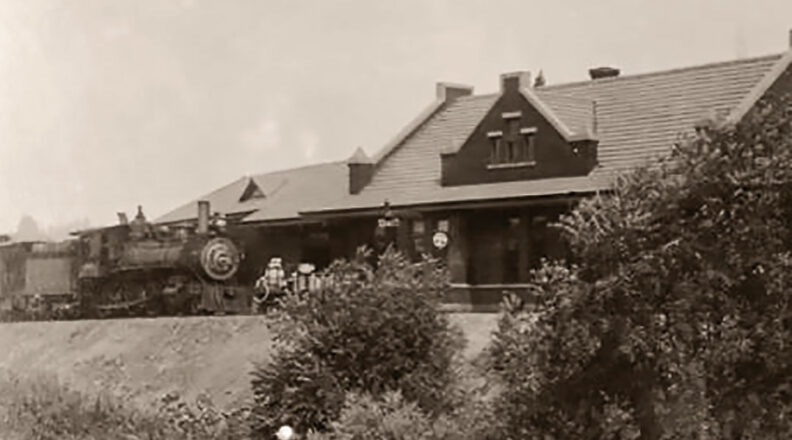 Train stopped in front of Pullman depot around 1920