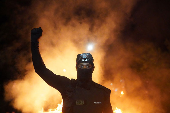 Protestor raises a fist during the 2020 Black Lives Matter protests in Portland, Oregon