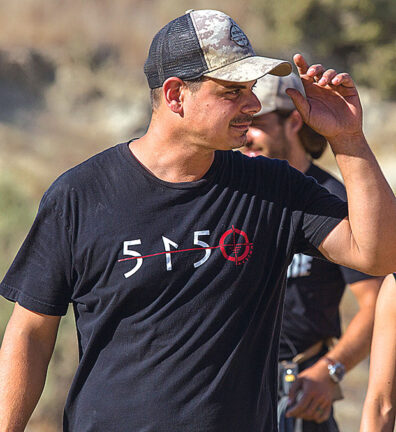 Andrew DeCesare in a baseball cap with a 5150 shirt directing Rogue Warfare