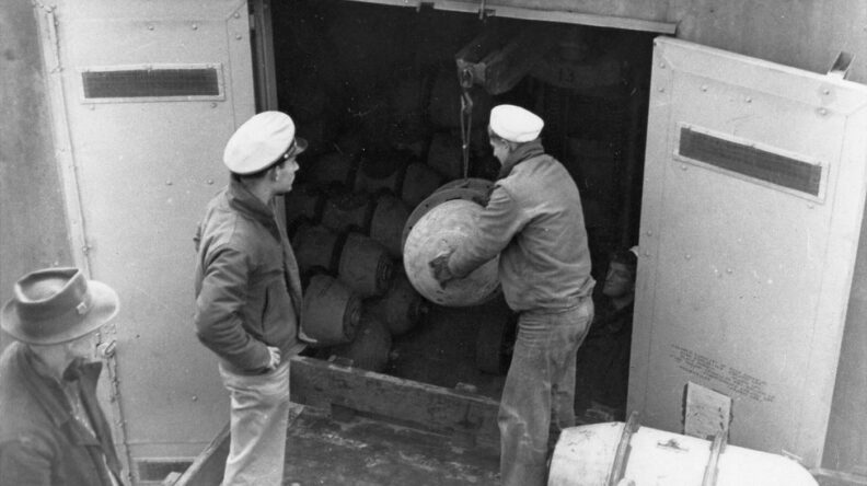 Navy soldiers storing ordnance at Indian Island