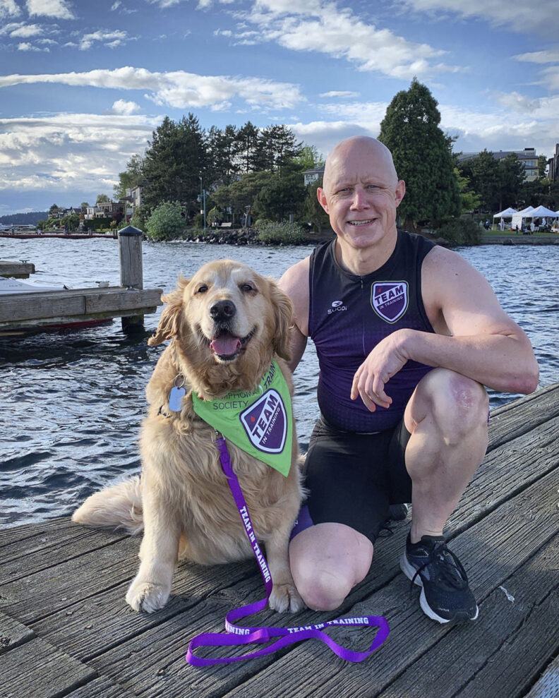 Dash Dog and Ande Edlund on a pier