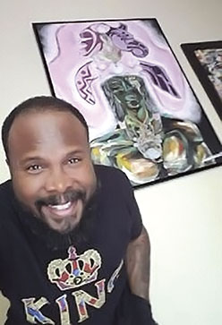 Hasaan Kirkland in front of one of his paintings