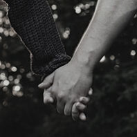 hand holding in black and white