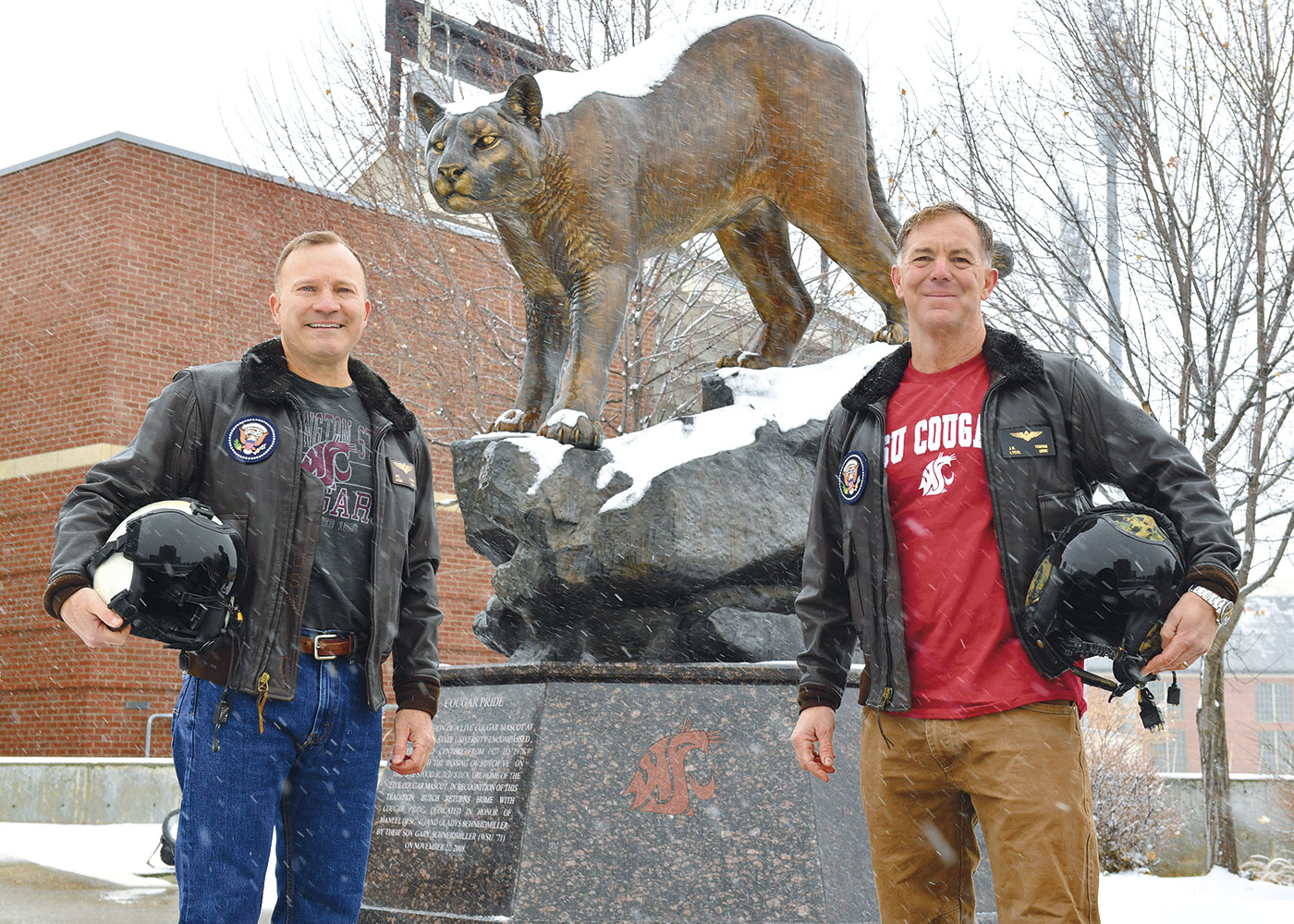 Dan Ircink and Jeff Tontini in front of WSU's Martin Stadium and cougar statue