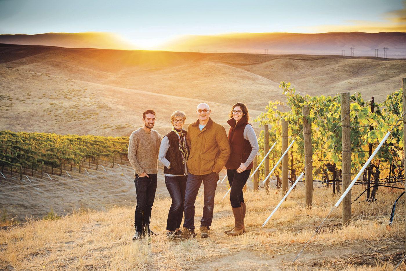 Sager Small, Darcey Fugman-Small, Rick Small, and Jordan Dunn-Small in a Woodward Canyon vineyard