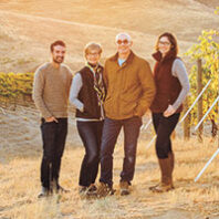 Sager Small, Darcey Fugman-Small, Rick Small, and Jordan Dunn-Small in a Woodward Canyon vineyard