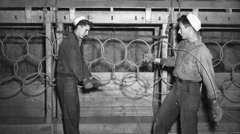 US Navy sailors working on anti-submarine nets