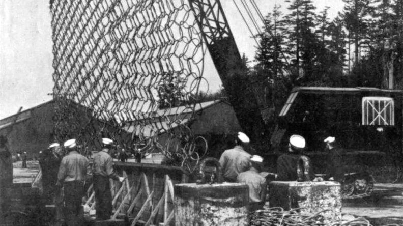 Crane lifts naval net