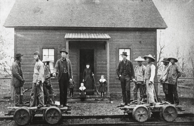 Chinese workers in front of a small building with the Oregon Railroad and Navigation Company