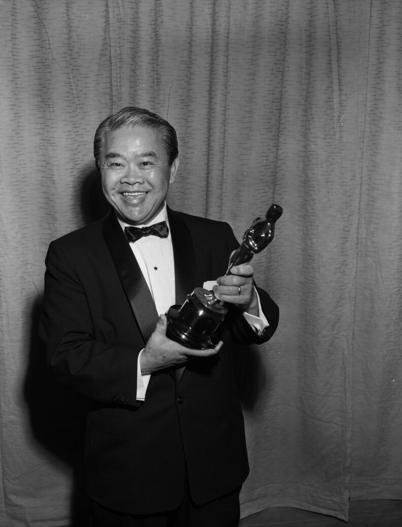 James Wong Howe with his Oscar for cinematography in 1956