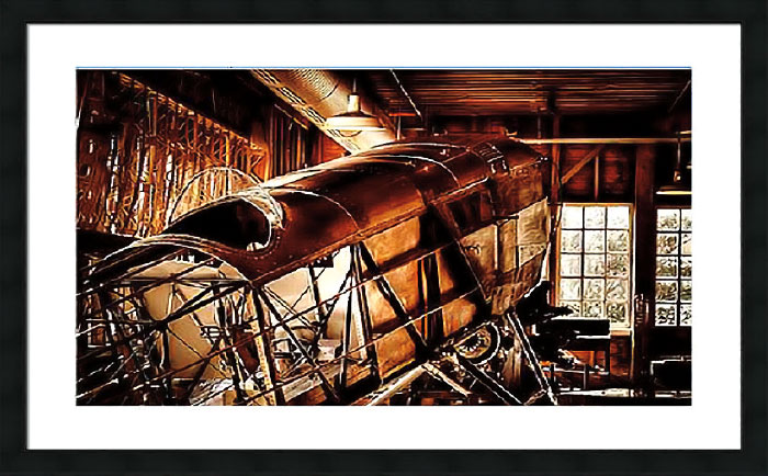 Photograph of old plane cockpit in a barn