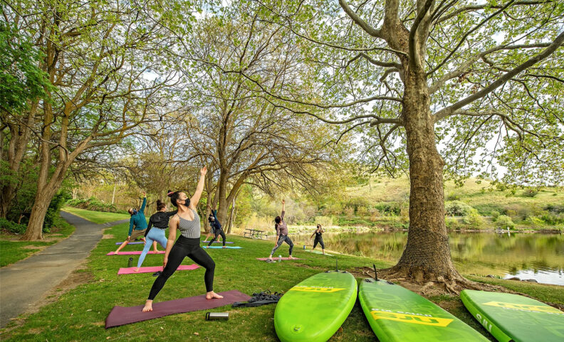 Young people in masks doing yoga outside near the Snake River in Washington