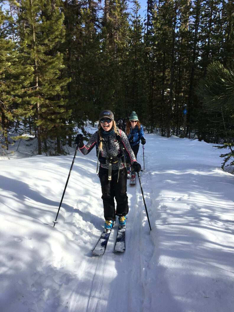 Two young women crosscountry skiing in a forest at Moscow Mountain in Idaho