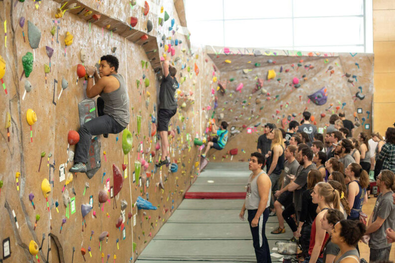 College students at Washington State University scale the climbing wall at the Outdoor Recreation Center