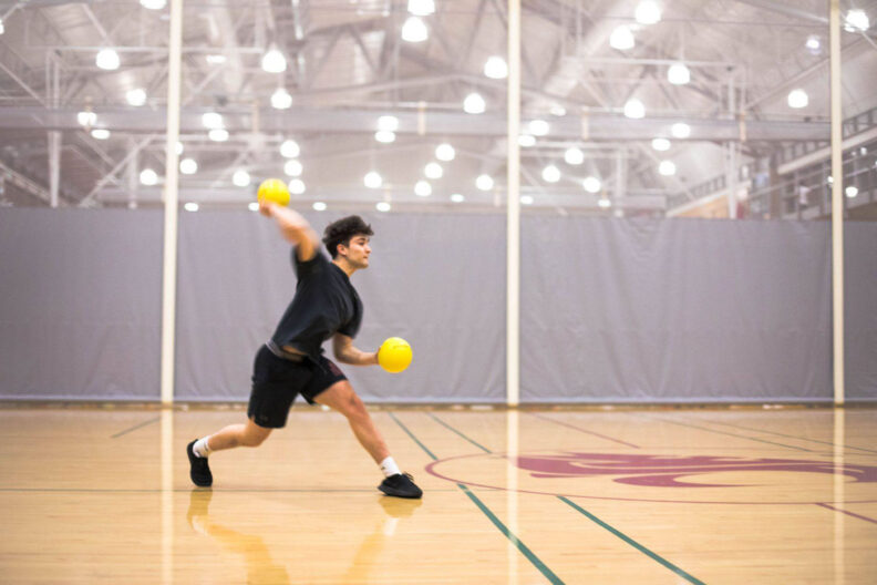 Young man plays dodgeball at WSU Student Recreation Center