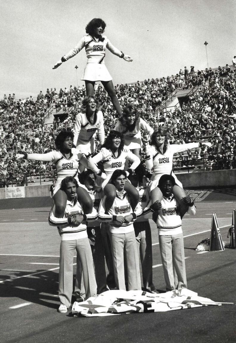 WSU cheerleaders in 1979 performing a human pyramid on the football field