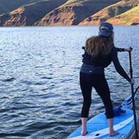 Woman on a paddleboard riding the Snake River