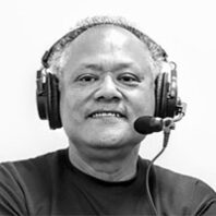 Enrique Cerna with headphones and microphone