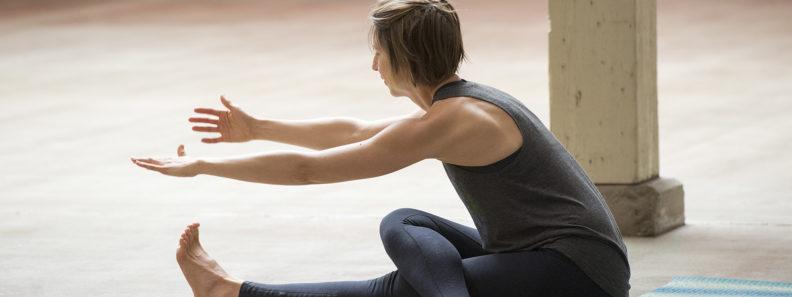 Campus yoga instructor Jenni Wade demonstrates a yoga pose