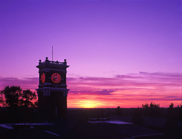 Bryan Hall clock tower with purple pink and yellow sunset